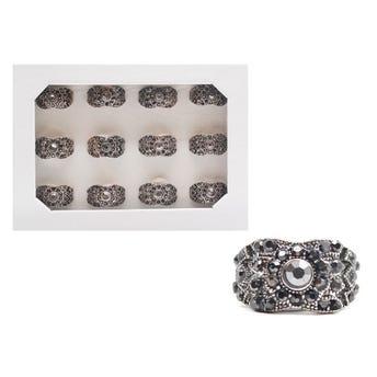 Anillo metálico rústico con cristales, tallas surtidas.