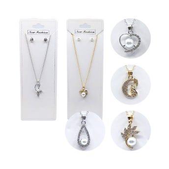 Collar con aretes de perlas con dije de cristales, mod y col surtidos.