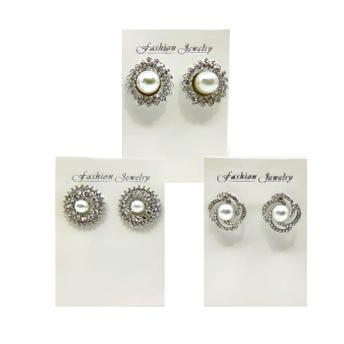 Arete metálico flor con perla y cristales, inner por mod sujeto a disp, plateado.