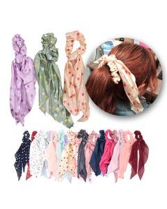 Dona para cabello textil con listones colgantes, col surt, inner por mod sujeto a disp, 9 X 34 cm.