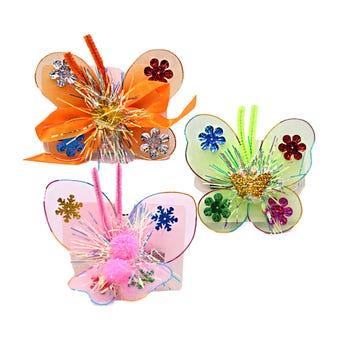 Pinza para cabello caimán mariposa textil, inner por mod sujeto a disp, col surt, 9.5 X 11.5 cm.